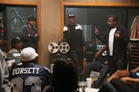 STRAIGHT OUTTA COMPTON, Jason Mitchell, as Eazy-E (sitting, left), O'Shea Jackson Jr., as Ice Cube (arms folded), Corey Hawkins, as Dr. Dre (standing, center), director F. Gary Gray, on set, 2015. ph: Jamie Trueblood/©Universal Pictures