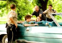 THE YELLOW HANDKERCHIEF, in car from left: Eddie Redmayne, Kristen Stewart, standing, moustache: William Hurt, 2008. ©Samuel Goldwyn Films