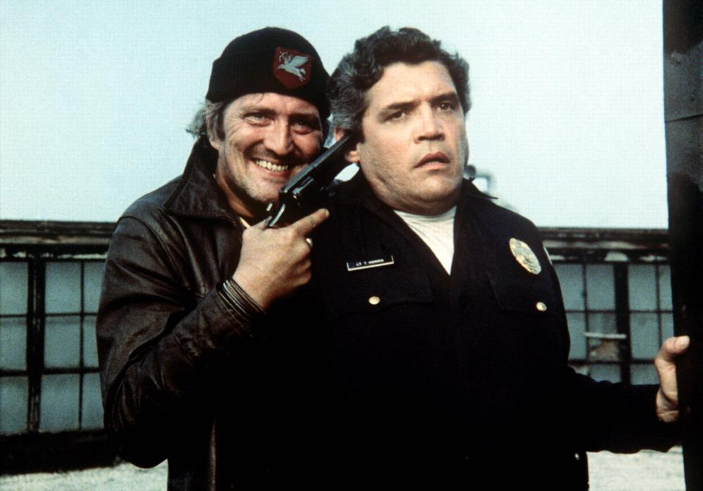 POLICE ACADEMY, G.W. Bailey (right), 1984, (c) Warner Brothers