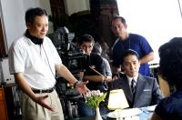 LUST, CAUTION, (aka SE, JIE), director Ang Lee, Tony Leung Chiu Wai (sitting, right), on set, 2007. ©Focus Features