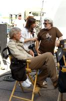 INDIANA JONES AND THE KINGDOM OF THE CRYSTAL SKULL, (aka INDIANA JONES 4), Harrison Ford, executive producers Kathleen Kennedy, George Lucas, on set, 2008. ©Paramount