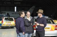 THE DA VINCI CODE, producer Brian Grzer, screenwriter Akiva Goldsman, director Ron Howard on set, 2006, (c) Columbia