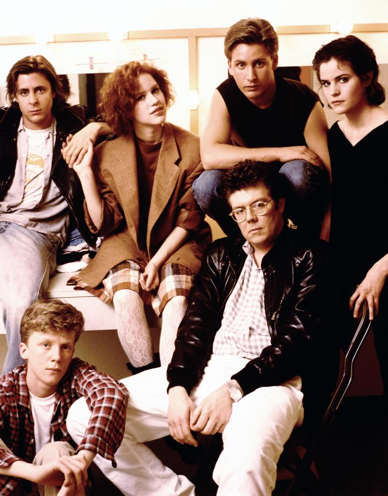 THE BREAKFAST CLUB, Judd Nelson, Anthony Michael Hall, Molly Ringwald, Emilio Estevez, director John Hughes, Ally Sheedy on the set, 1985. (c)Universal Pictures..