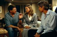 WHAT LIES BENEATH, Robert Zemeckis, Michelle Pfeiffer,  Harrison Ford, 2000, the director goes over a scene.