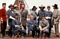 GETTYSBURG, (standing l-r): James Lancaster, Royce Applegate, Tim Ruddy, Richard Jordan, Ivan Kane, Tom Berenger, Kieran Mulroney, Cooper Huckabee, (seated l-r): Stephen Lang, Martin Sheen, Bo Brinkman, 1993, (c)New Line Cinema