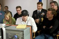 G.I. JOE: THE RISE OF COBRA, producer Bob Ducsay (eyeglasses), director Stephen Sommers (white shirt), Dennis Quaid (military uniform), cinematographer Mitchell Amundsen (front right), producer David Womark (right), on set, 2009. Ph: Frank Masi/©Paramount