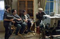 LINCOLN, writer Tony Kushner (sitting, left), director Steven Spielberg (right), on set, 2012, ph: David James/TM and Copyright ©20th Century Fox Film Corp. All rights reserved.