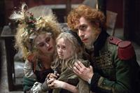 LES MISERABLES, from left: Helena Bonham Carter, Isabelle Allen, Sacha Baron Cohen, 2012. ©Universal Pictures