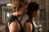 THE HUNGER GAMES: CATCHING FIRE, from left: Sam Claflin, Jennifer Lawrence, 2013. ph: Murray Close/©Lionsgate