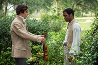 12 YEARS A SLAVE, from left: Benedict Cumberbatch, Chiwetel Ejiofor, 2013. ph: Jaap Buitendijk/TM and copyright ©Fox Searchlight Pictures. All rights reserved.