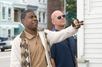 "(L-r) TRACY MORGAN as Paul and BRUCE WILLIS as Jimmy in Warner Bros. Pictures crime comedy ""Cop Out"". PHOTOGRAPHS TO BE USED SOLELY FOR ADVERTISING, PROMOTION, PUBLICITY OR REVIEWS OF THIS SPECIFIC MOTION PICTURE AND TO REMAIN THE PROPERTY OF THE STUDIO. N"