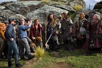 THE HOBBIT: AN UNEXPECTED JOURNEY, Stephen Hunter (left), James Nesbitt (back left), director Peter Jackson (hands raised), Martin Freeman (left of center), Richard Armitage (center), Aidan Turner (right of center), Dean O'Gorman (holding bag), William Kir