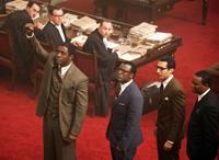MANDELA: LONG WALK TO FREEDOM, standing from left: Idris Elba as Nelson Mandela, Tony Kgoroge, Riaad Moosa, Thapelo Mokoena, 2013. ph: Keith Bernstein/©Weinstein Company