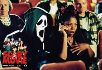 SCARY MOVIE, Dave Sheridan (mask), Regina Hall (cell Phone), lower left back row: Lochlyn Munro, Carmen electra, Shawn Wayans, front row: Marlon Wayans, Dave Sheridan, Shannon Elizabeth, 2000, © Dimension Films/courtesy Everett Colelction