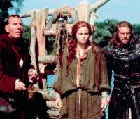 DRAGONHEART, from left: Pete Postlethwaite, Dina Meyer, Dennis Quaid, 1996, © Universal