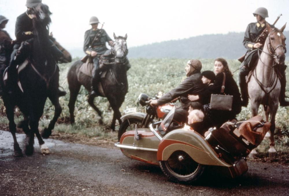 THE BOAT IS FULL, (aka DAS BOOT IST VOLL), (on motorcycle), Mathias Gnadinger, Laurent, Renate Steiger, 1981, (c) Quartet Films